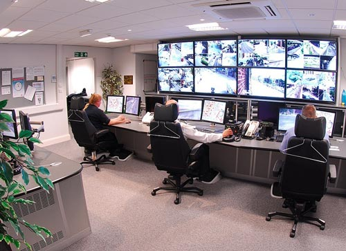 Security experts monitoring cameras