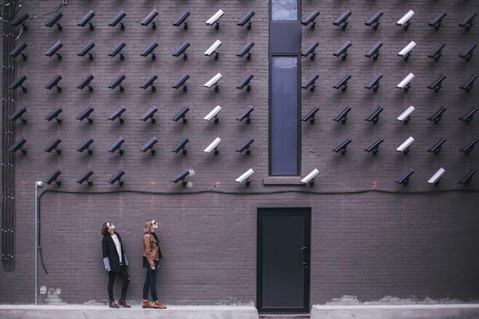 women looking at security cameras